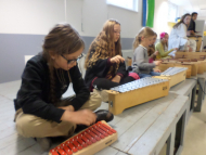 Glockenspiel and xylophones play the melody of the song.